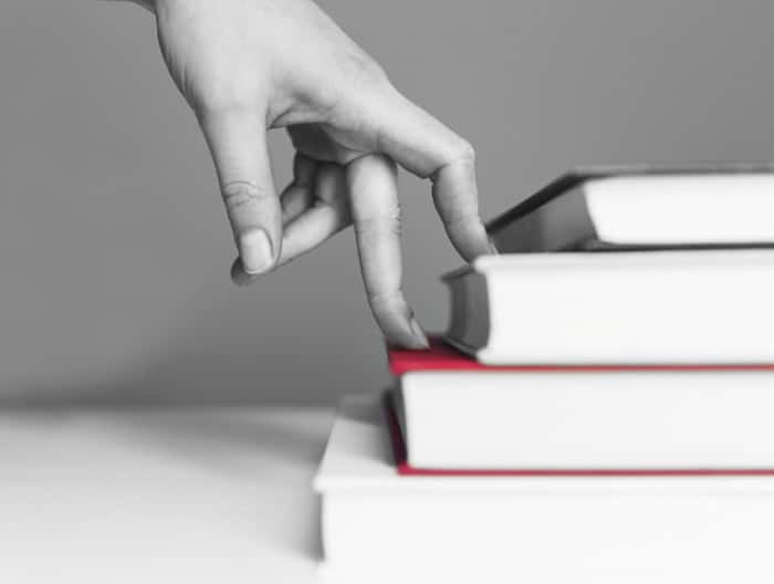 WP Creative, Design and Marketing Agency Suffolk, Copy Writing Services, A Hand Travelling up a Book Depicting Engaged Online Content